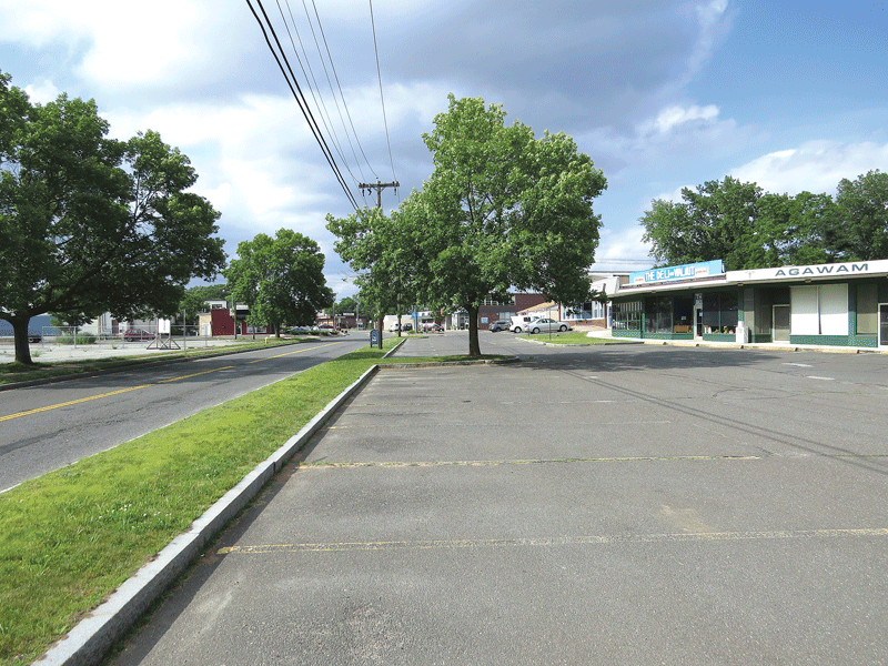 Redevelopment of the Games & Lanes property, top, is considered one of the keys to revitalization of the Walnut Street Extension retail corridor, above.