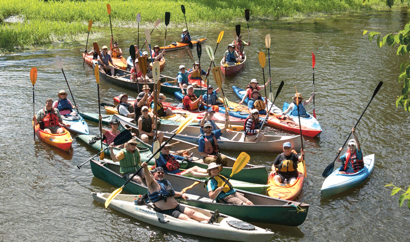 A paddlers group celebrates today's Connecticut River.
