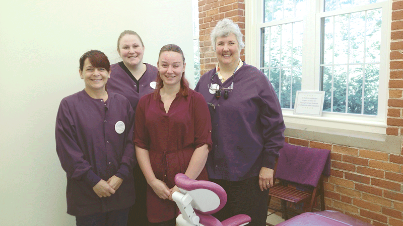 Dr. Sue Keller (far right) with some of her staff at Strong & Healthy Smiles