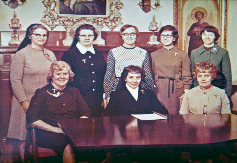 Sister Caritas (a.k.a. 'little sister'), front row, center