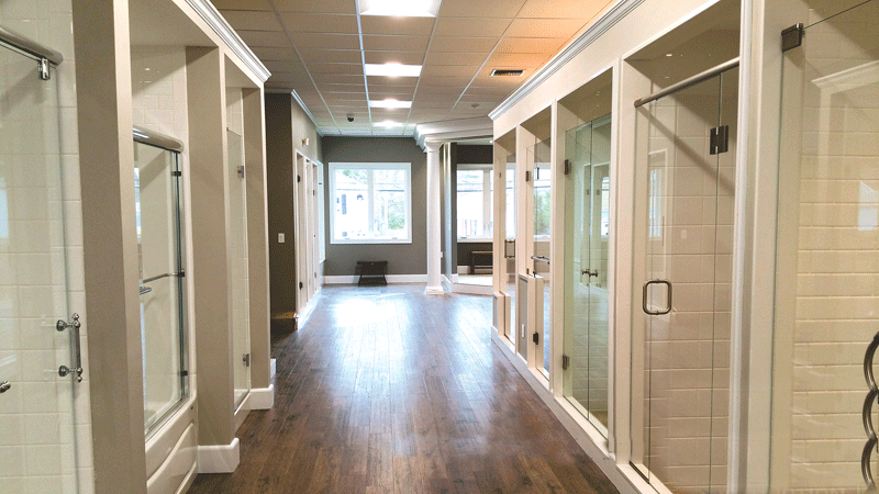 A. Crane Construction recently tackled a major renovation form Oasis Shower Doors.