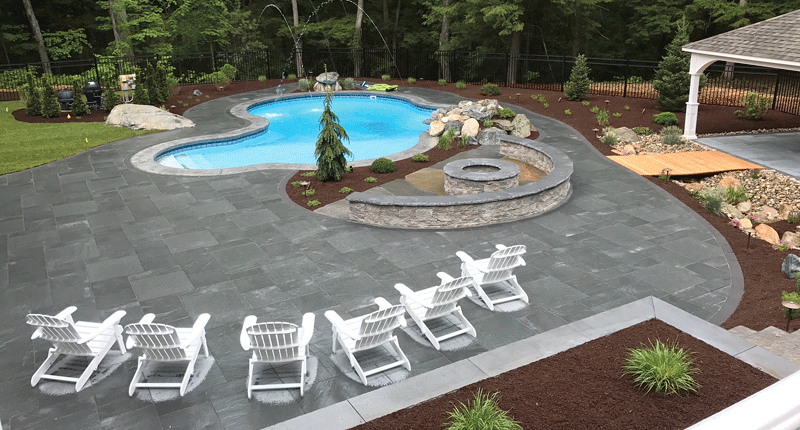 A poolside patio built by RJM Landscaping.