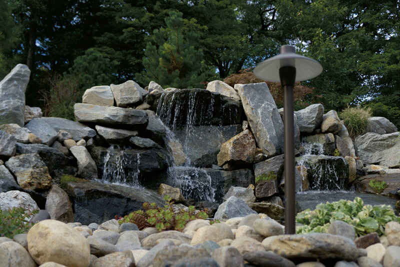 Brian Campedelli says many customers want natural-looking water features around their pools.