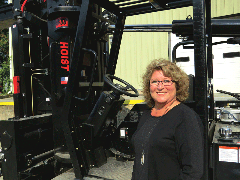 Company President Carol Campbell shows off new CIC's new 40-60 Hoist.