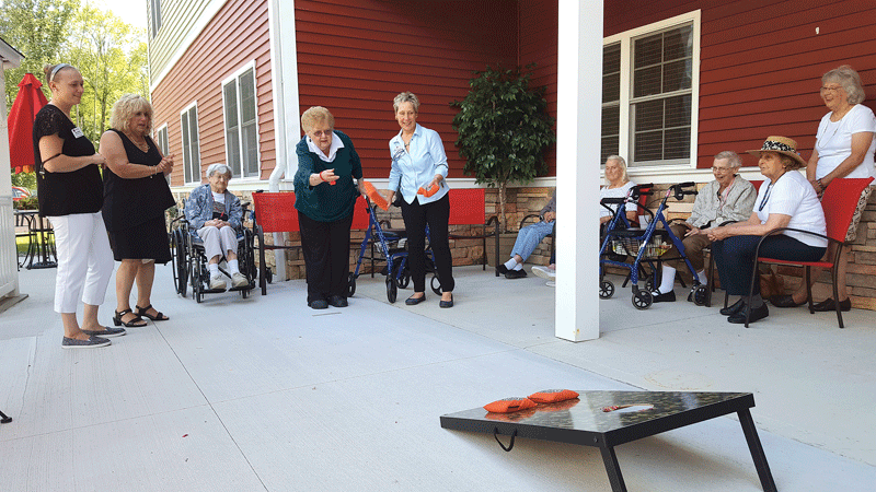 With ConnectedLIFE, seniors get as many chances as they need to get the bean bag into the hole.
