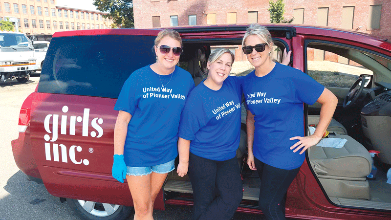 Three employees from MassMutual spent the day volunteering with Girls Inc. in Holyoke and washed down all over their transportation vehicles.