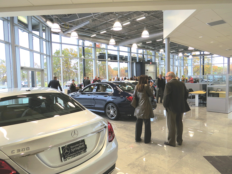 Attendees mingle in the showroom prior to the ceremonies
