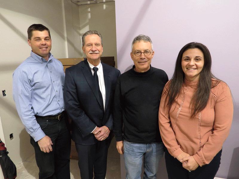 From left: Cameron Carey, Community Health Center development director; Jim Goodwin; Ed Sayer; and Shannon Hicks, CHD clinic director.
