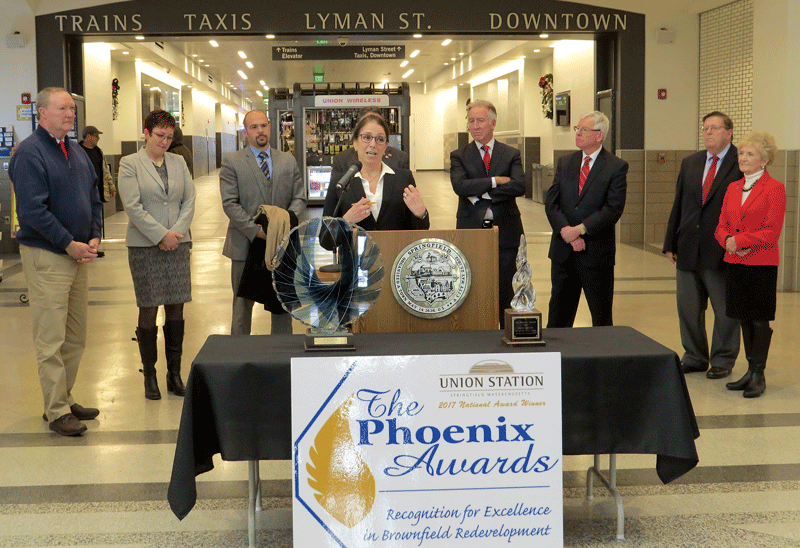 Lauren Liss, president and CEO of MassDevelopment, addresses those assembled at a press conference on Dec. 11