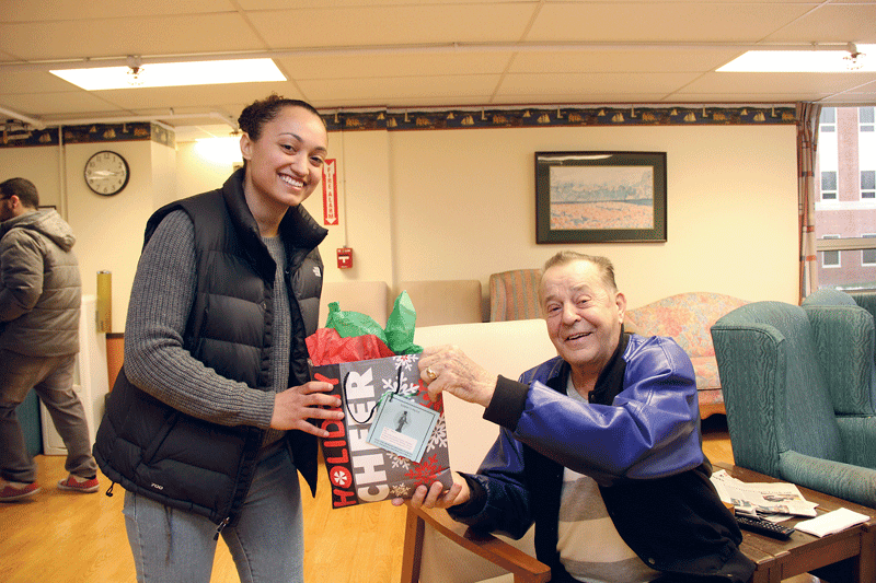 HCC student Ysabel Robles Ramos delivering holiday gift bags to Soldiers' Home residents