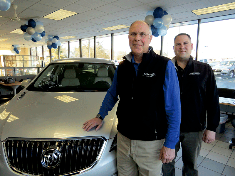 Don Pion, seen here with his son, Rob, general manager of the dealership, says the soaring popularity of SUVs and crossovers has helped fuel solid sales for the industry.
