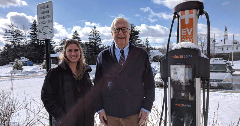 Linda Leduc and Charlie Blanchard stand beside one of Palmer's two new charging stations for electric cars.