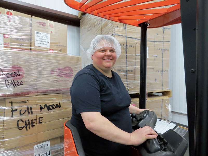When Liz Buxton says she's chief cook and bottle washer at the WMFPC, she means it. Yes, she also drives the fork truck on occasion.