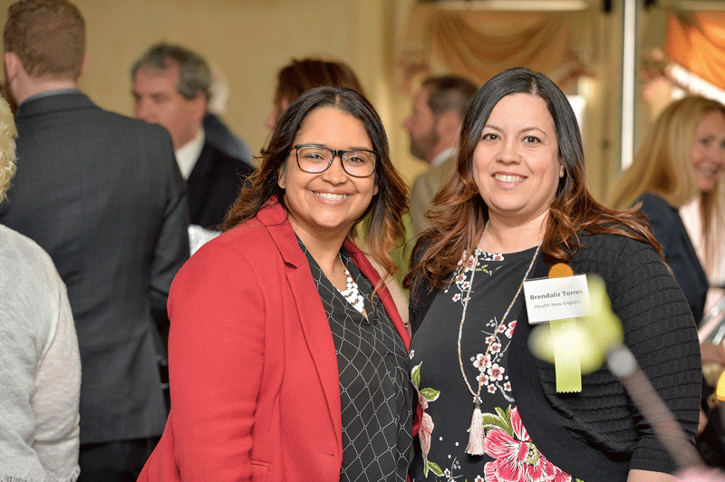 Sandra Ruiz, left, and Brendaliz Torres, from event sponsor Health New England.