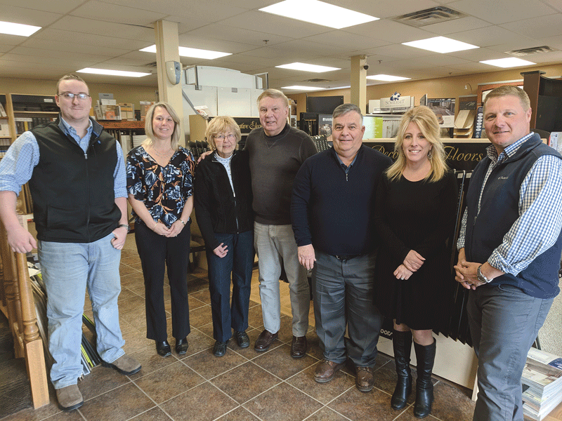 President Mitch Salomon (center) and some of his team at Salomon Flooring.