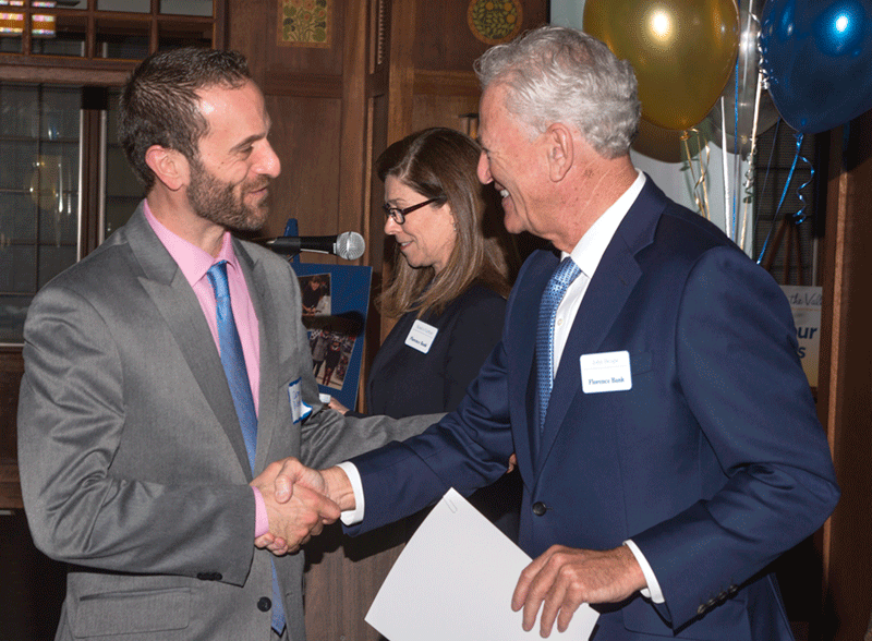 Florence Bank President and CEO John Heaps Jr., right, shakes hands with Carmine DiCenso, executive director of Dakin Humane Society, the top program recipient with a $5,000 award.