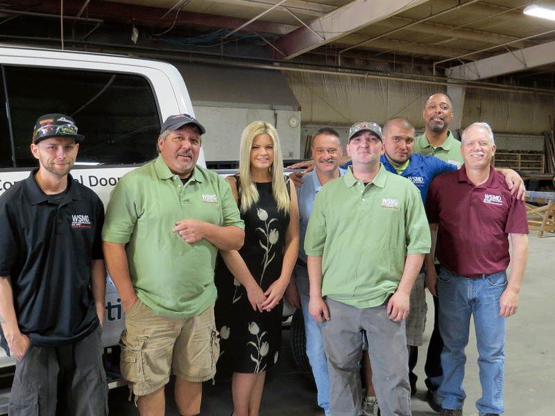 Amy Royal, seen here with many of the team members at WSMD, says she was drawn by the company's rich history and strong growth potential.