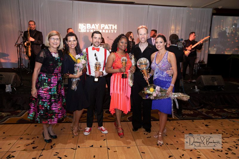From left to right, President Leary joins the dancers at the end of the competition, Daryll Sverrisson '98, Delcie Bean IV, Maria Rodriguez-Furlow ''10 G'12 of Bay Path, Gunnar Sverrisson, and the winner of the Mirror Ball Trophy:  Patricia Faginski.