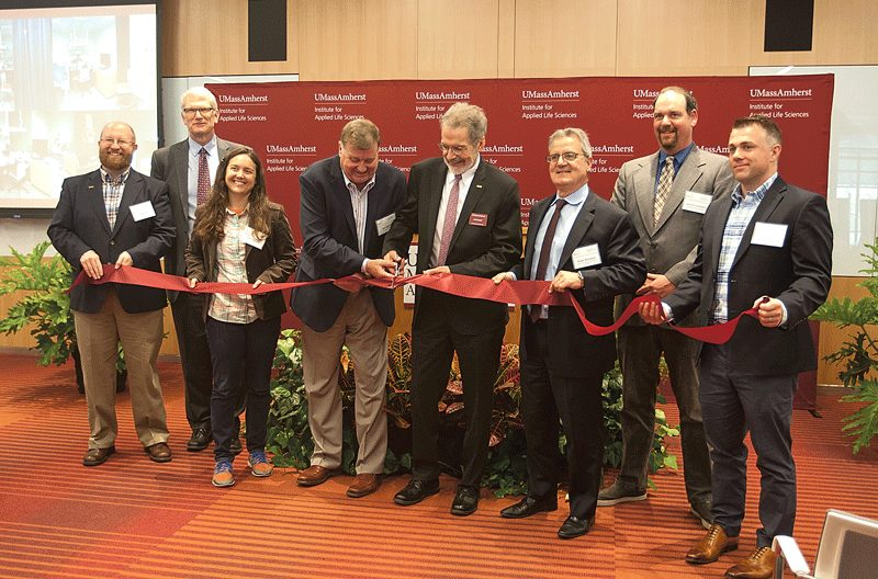 Jim Hamlin, vice president of sales for Nikon Instruments Inc., and Mike Malone, vice chancellor for Research and Engagement at UMass Amherst, cut the ribbon for the lab's grand opening.