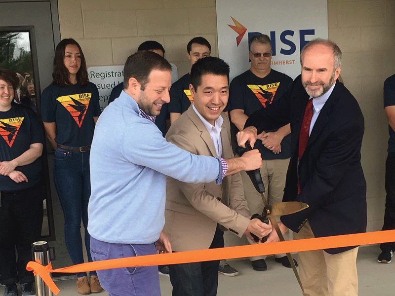 Cutting the ribbon are, from left, Kadens; Matt Yee, GTI Massachusetts market president; and Peter Vickery, Amherst Area Chamber of Commerce president.