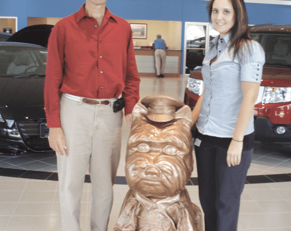 Mike Dubois, left, vice president of Finance for Balise Motor Sales, and Balise graphic artist Crystal Childs