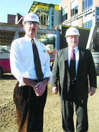 Bill Aquadro, left, and Steve Killian stand in the shadow of Cooley Dickinson Hospital's $40 million expansion project.
