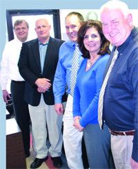 The leadership team at Entré Computer, from left, Bob Bellamy, Andi Aigner, Robert Braceland, Liz Soticheck, and Norm Fiedler.