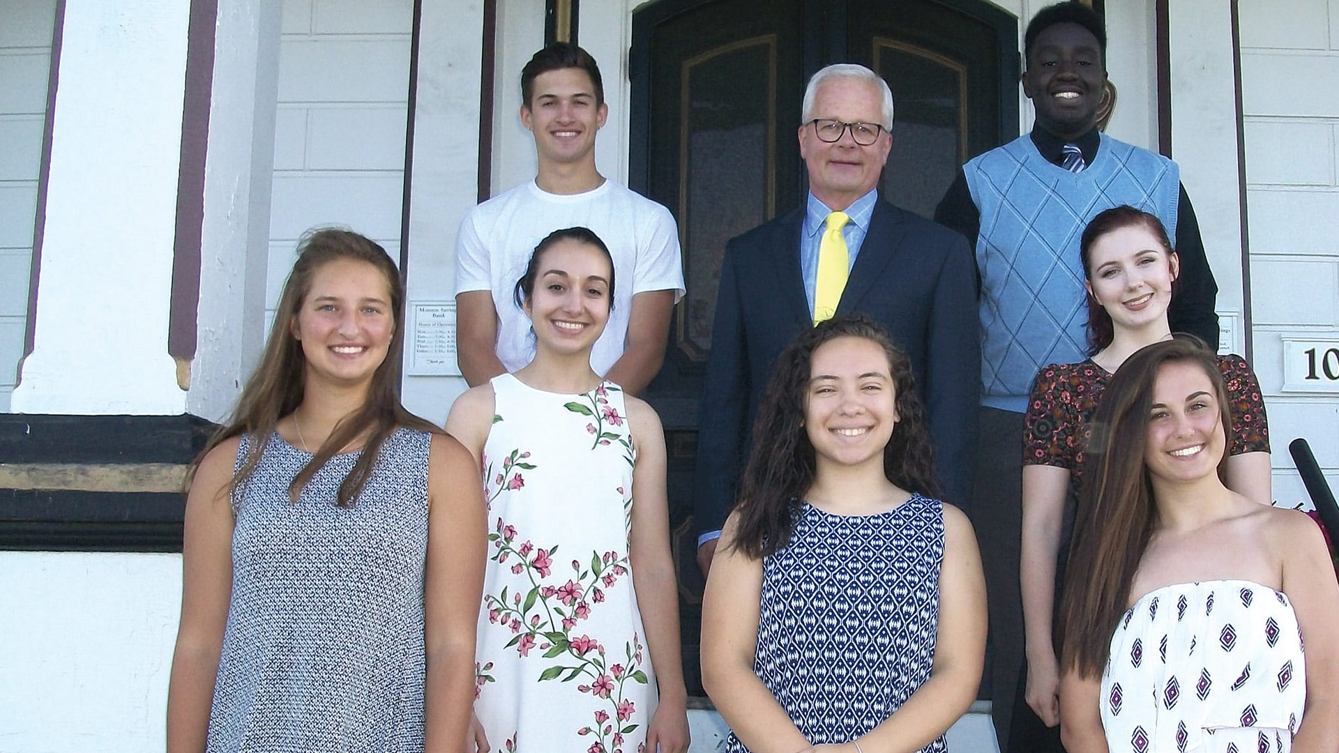 Steve Lowell, president and CEO of Monson Savings Bank, with some of the scholarship winners.