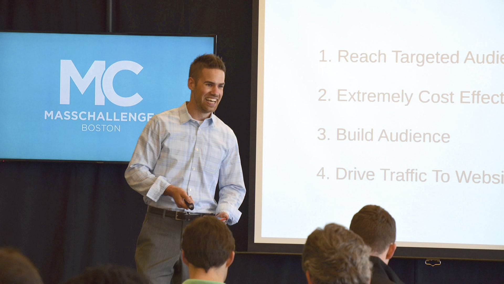 James Garvey, seen here presenting at a MassChallenge event