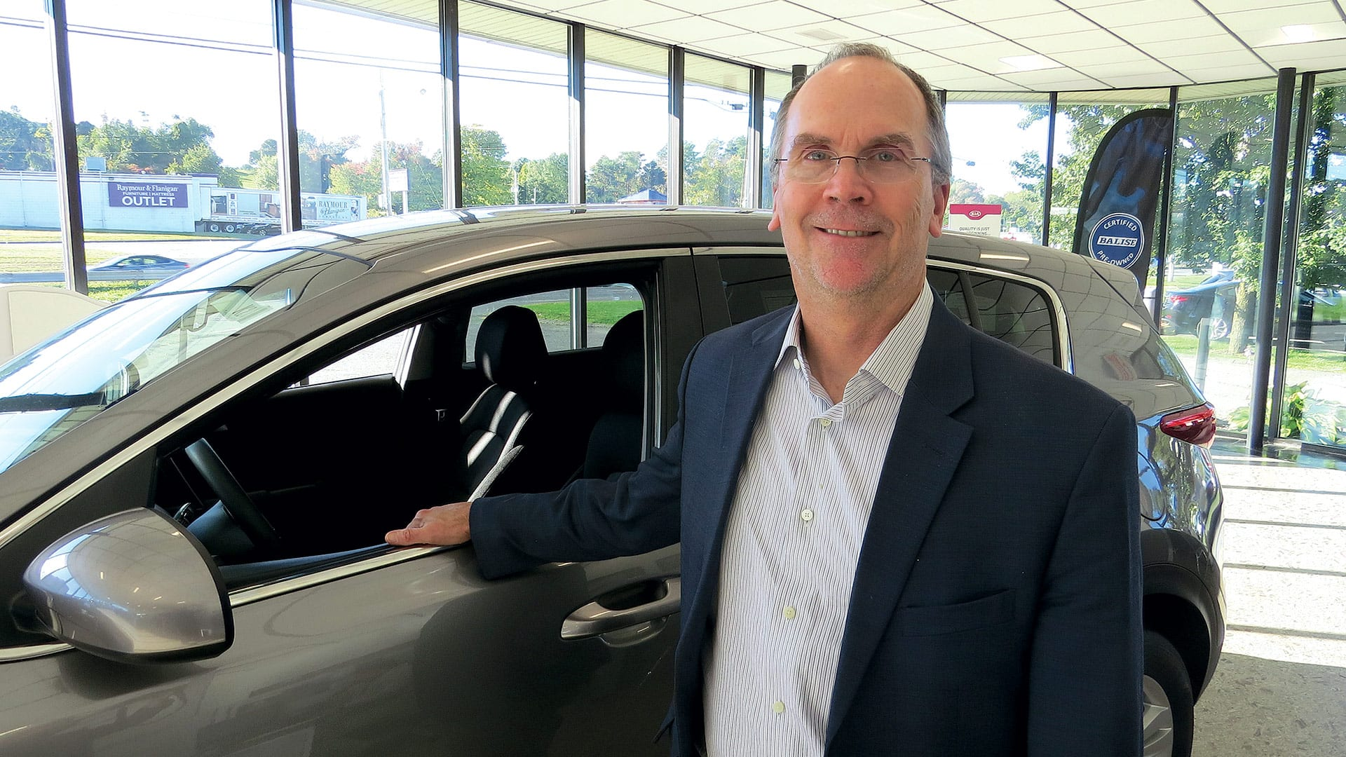 Jeb Balise, seen here at his company's Kia dealership on Riverdale Street