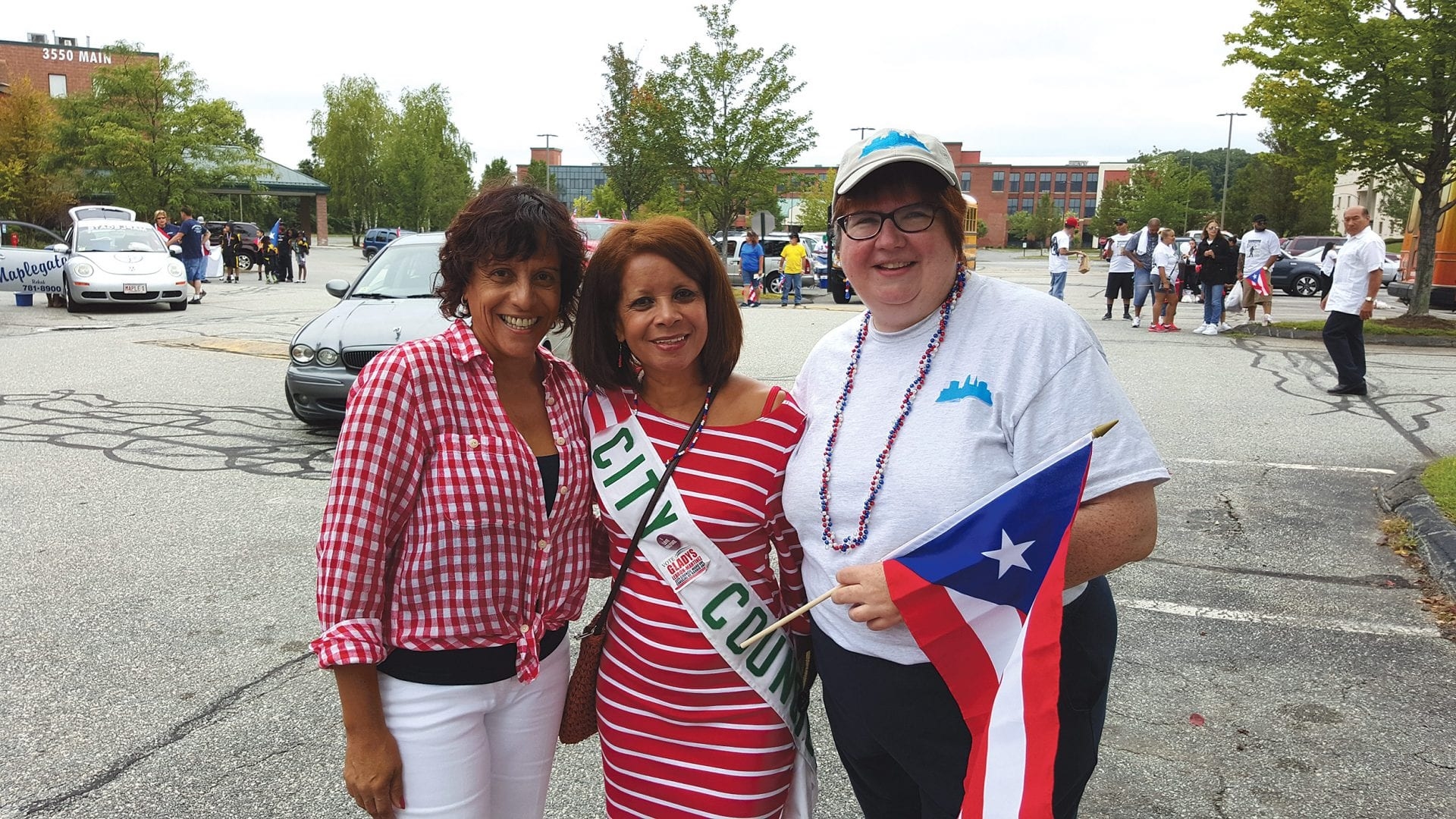 Jean Canosa Albano, right, with friends Maria Acuna, a Realtor, and Holyoke City Councilor Gladys Lebron, at the 2015 Puerto Rican Parade.