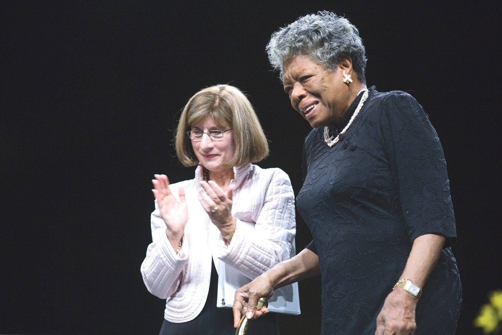 Carol Leary introduces poet Maya Angelou at one of Bay Path's Women's Leadership Conferences, one of many new programs and initiatives she has introduced.