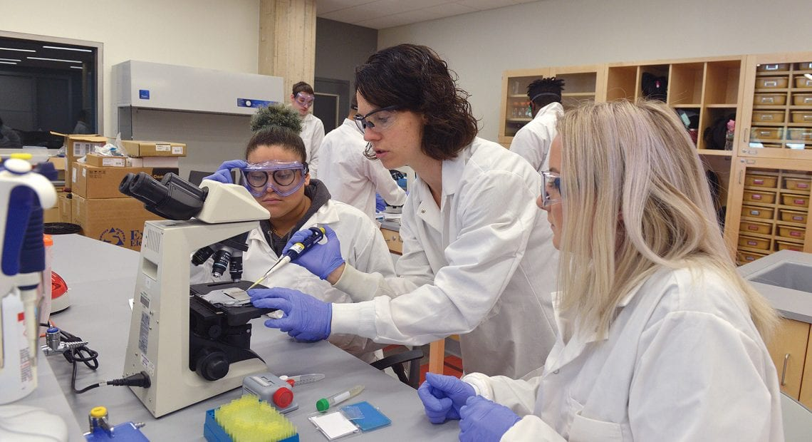 Emily Rabinsky guides two HCC students in a lab project.