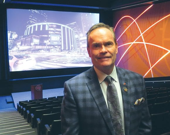 John Doleva shows off the Basketball Hall of Fame's renovated theater, one of many improvements at the hall.