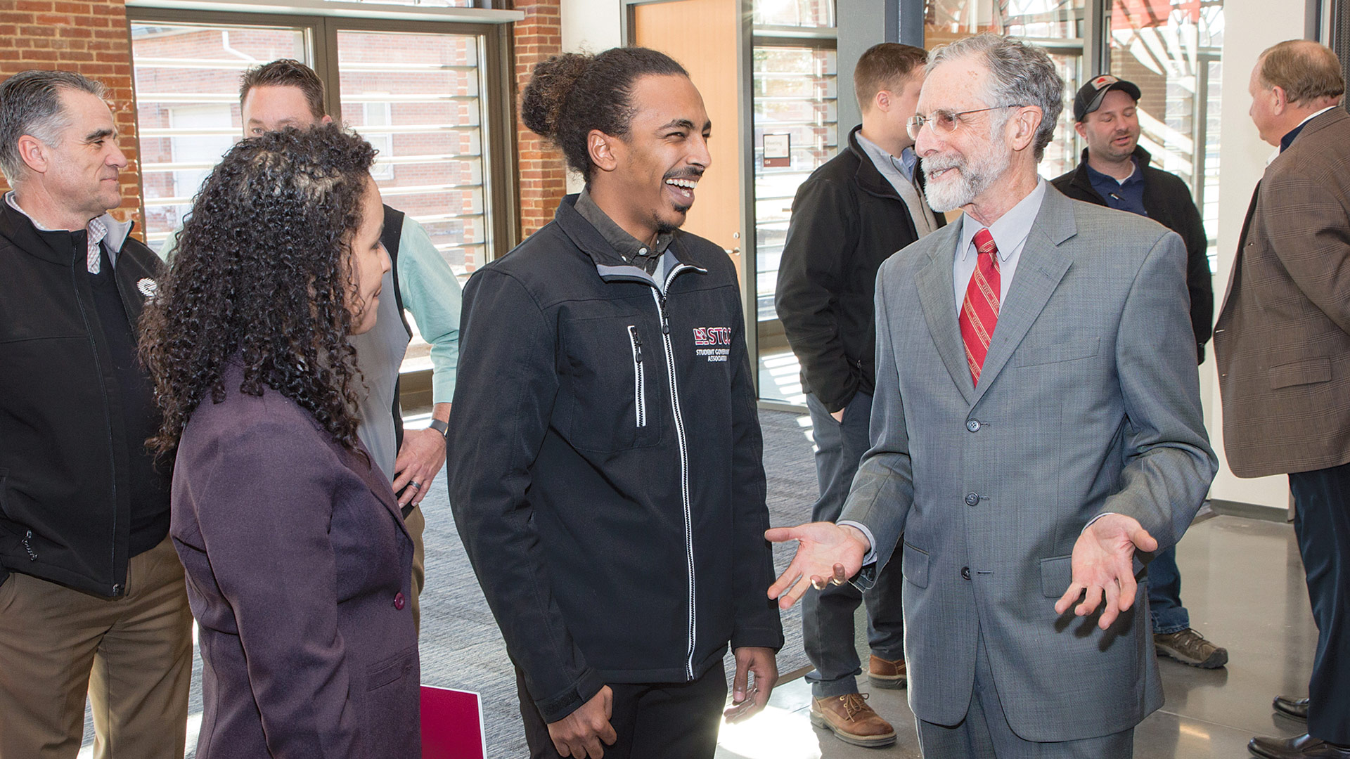 Rubenzahl chats with students Karolyn Burgos-Toribio and Mohammed Gabriel