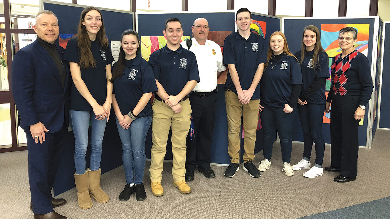 From left: Michael Moran, president of Baystate Mary Lane and Baystate Wing Hospital; students Valentina Towne, Morgan Orszulak, and Joe Gagnon; Wloch; students Seth Bourdeau, Felicity Dineen, and Jordan Trzpit; and Ware Superintendent of Schools Marlene DiLeo.