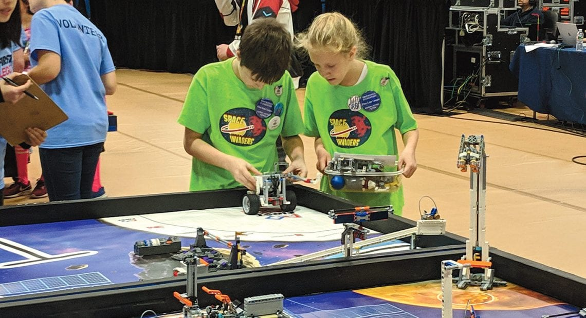 A team from Feeding Hills gets ready to put their robot to the test.