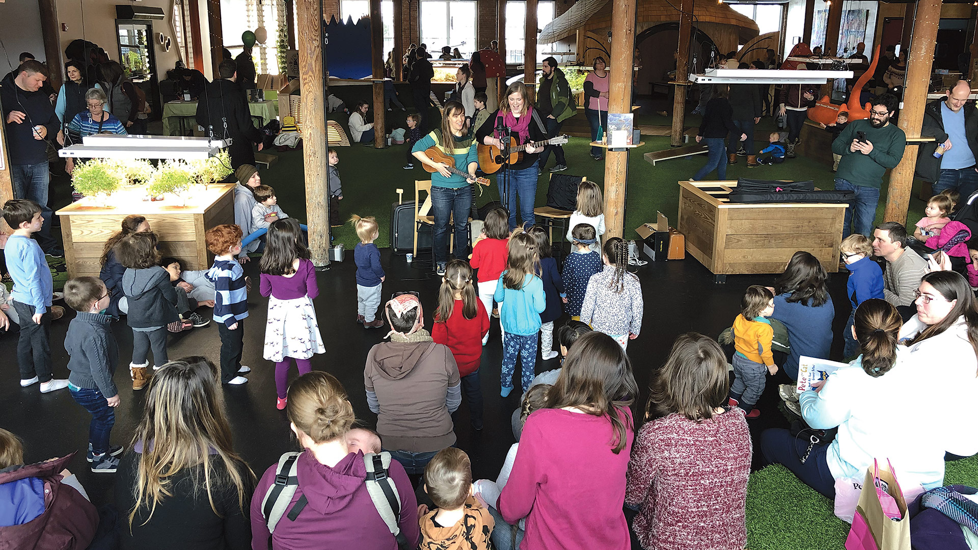 the children's musical group Little Roots performs at the event