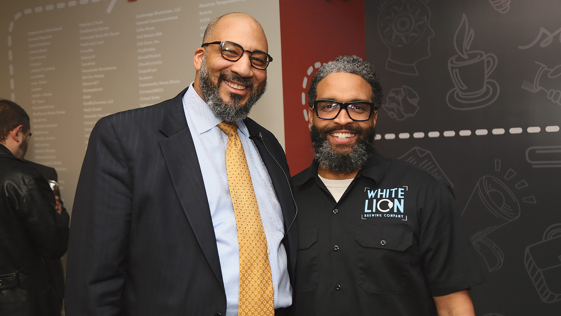 Gregory Thomas, executive director of the Berthiaume Center for Entrepreneurship at UMass Amherst, networks with Ray Berry, founder of White Lion Brewery