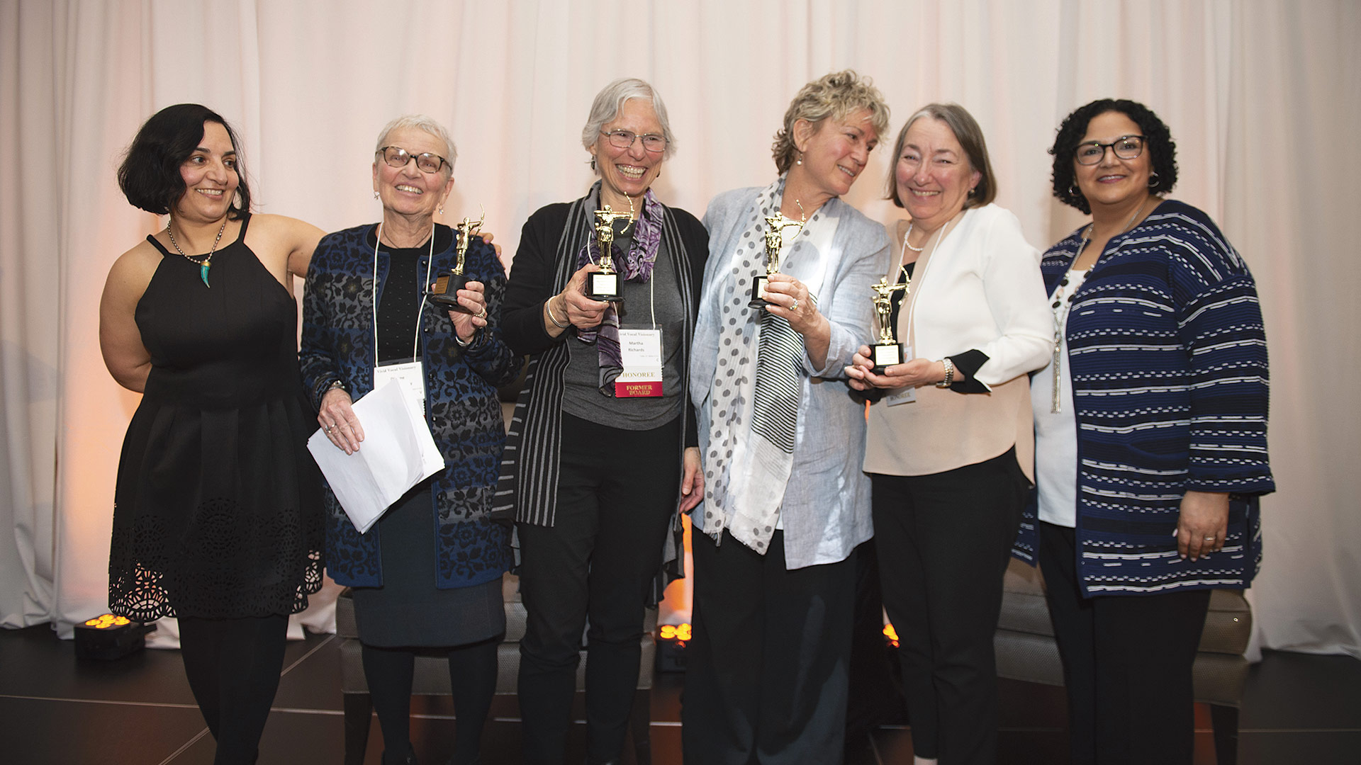 From left, Donna Haghighat, CEO of the WFWM, Doherty, Richards, Nelson, Mimi Ginsberg (accepting for Sally Livingston's family), and Haydee Lamberty-Rodriguez, board chair of the WFMA)
