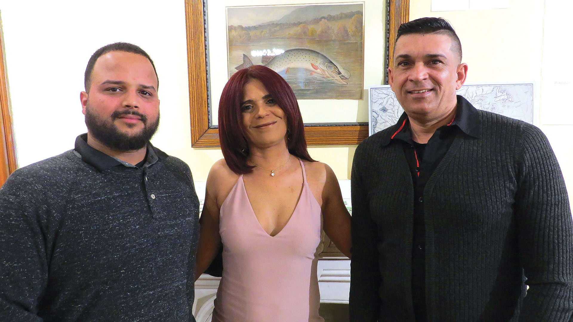 From left, Marcos Mateo, his mother, Madeline, and Abiel Alvarado, look to open their auto-service business in June.