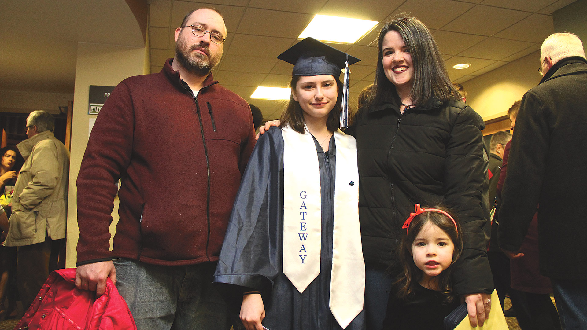 Biannca Colflesh of Holyoke, one of the 15 graduates, celebrates with her family after the graduation ceremony