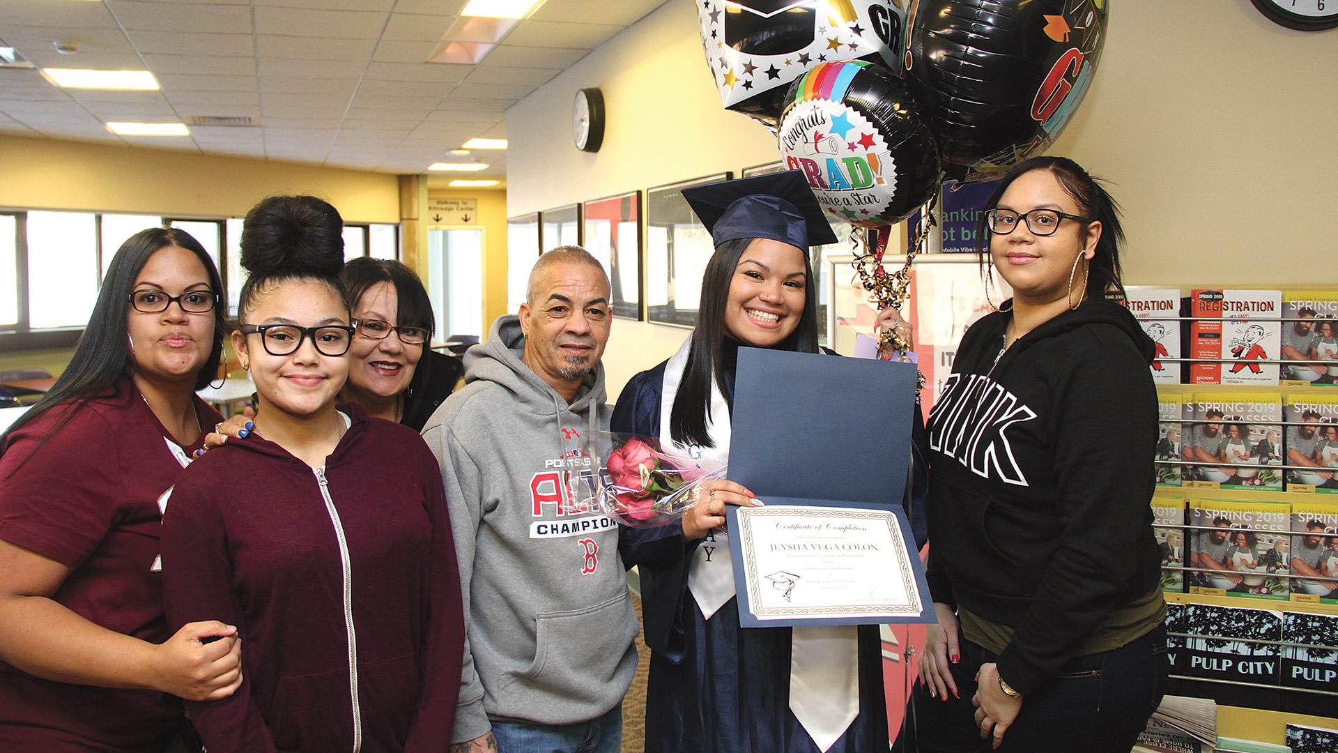 Jeysha Vega Colon of Springfield celebrates with her family
