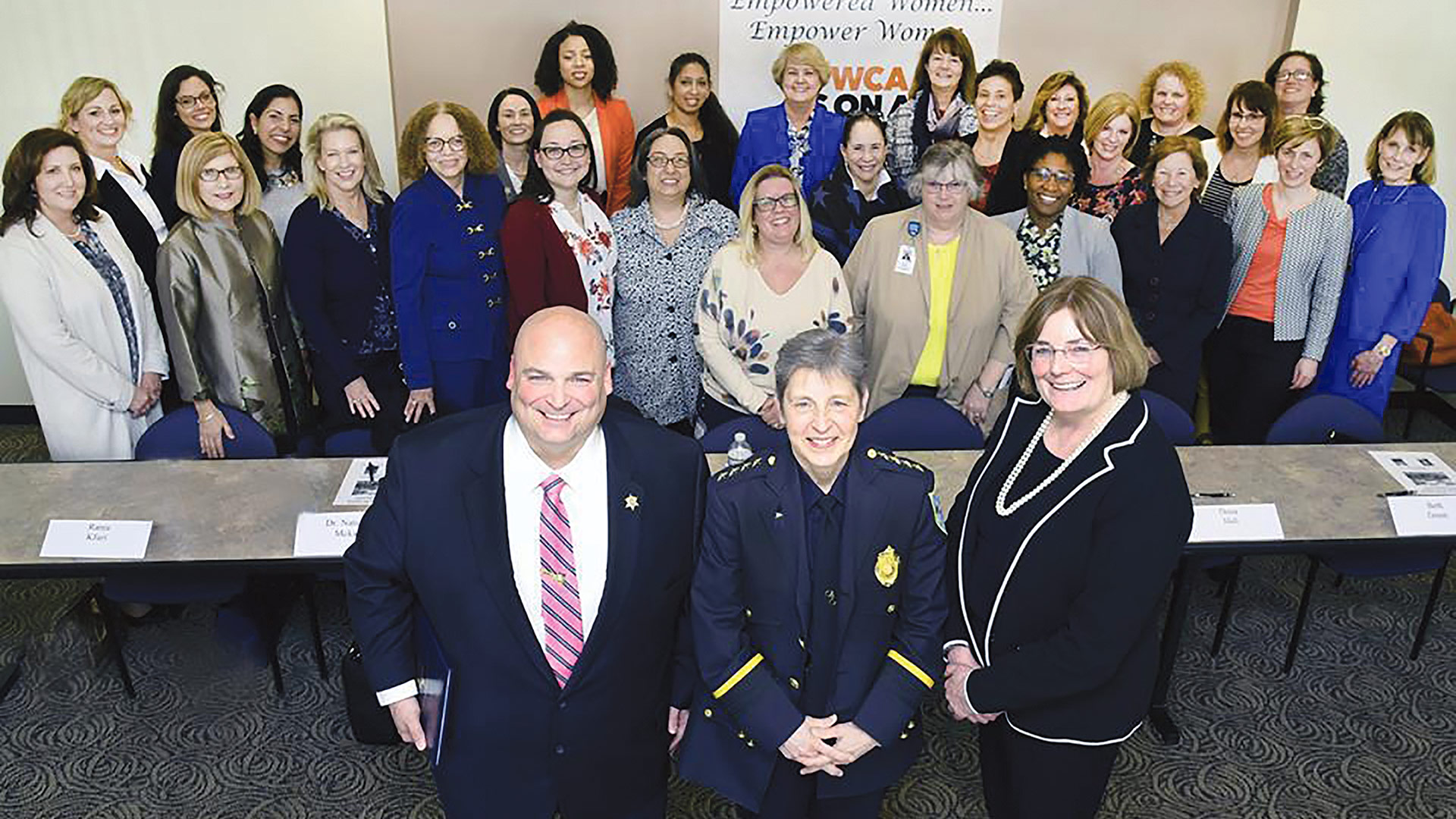 Claprood, center, with Hampden County Sheriff Nick Cocchi and YWCA Executive Director Elizabeth Dineen, a former prosecutor in Hampden County. Behind them are some of the more than 30 women who attended the event