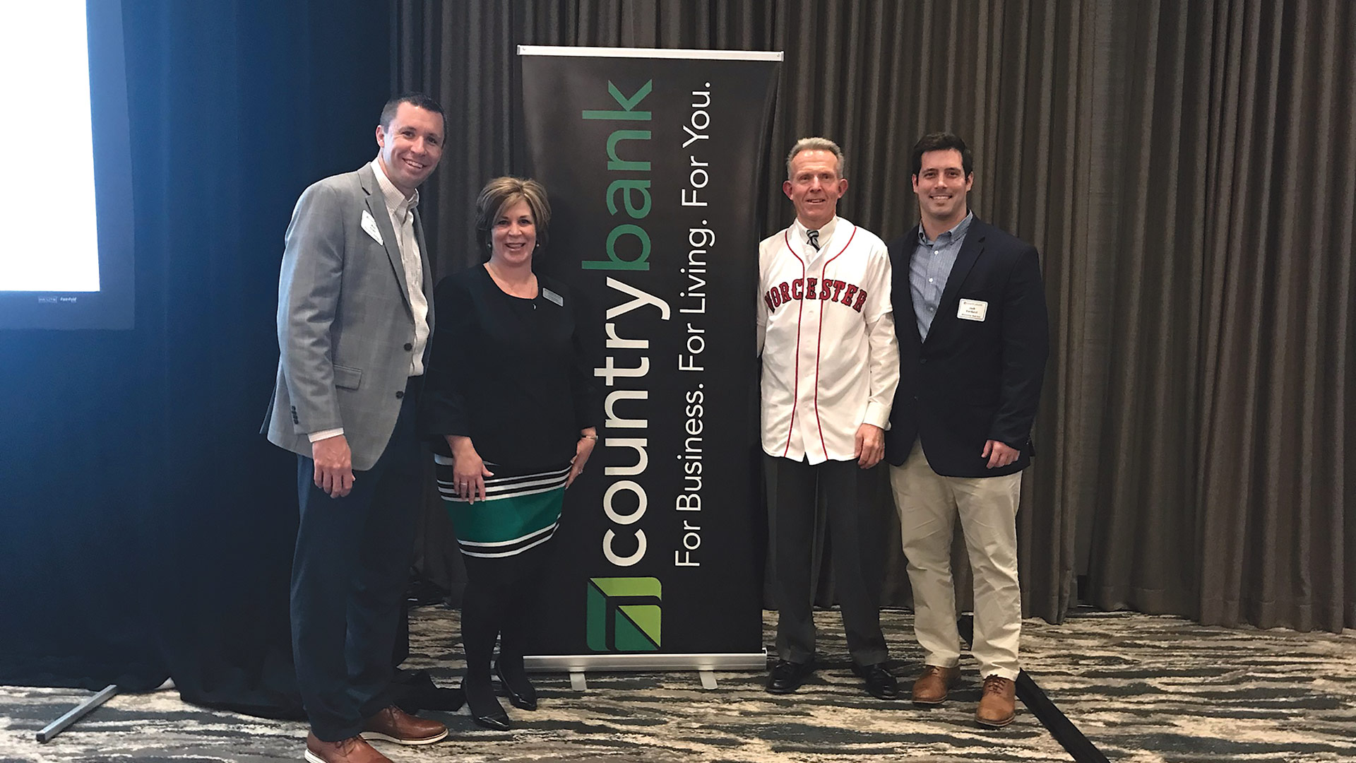 Pictured, from left, are Rob Crain, senior vice president of Marketing for the Worcester Red Sox; Shelley Regin, senior vice president of Marketing for Country Bank; Paul Scully, President and CEO of Country Bank, and Jack Verducci, vice president of Corporate Partnerships for the Worcester Red Sox.