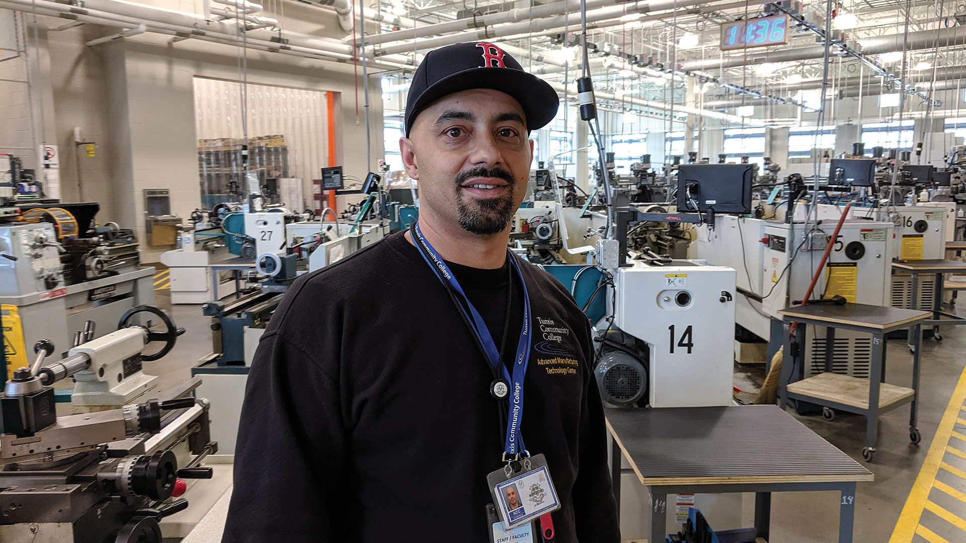 Joe Marcelino with some of the 90 devices on the machining floor of the center's 2017 expansion