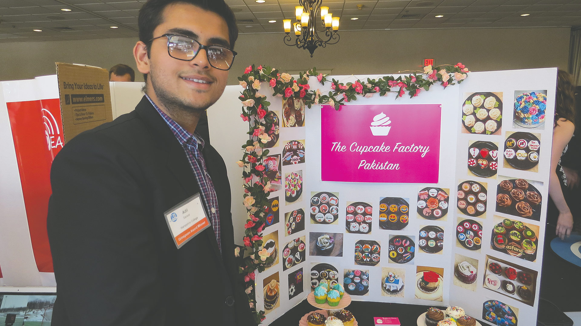 Hampshire College student Adil Sarwar shows off his venture, the Cupcake Factory