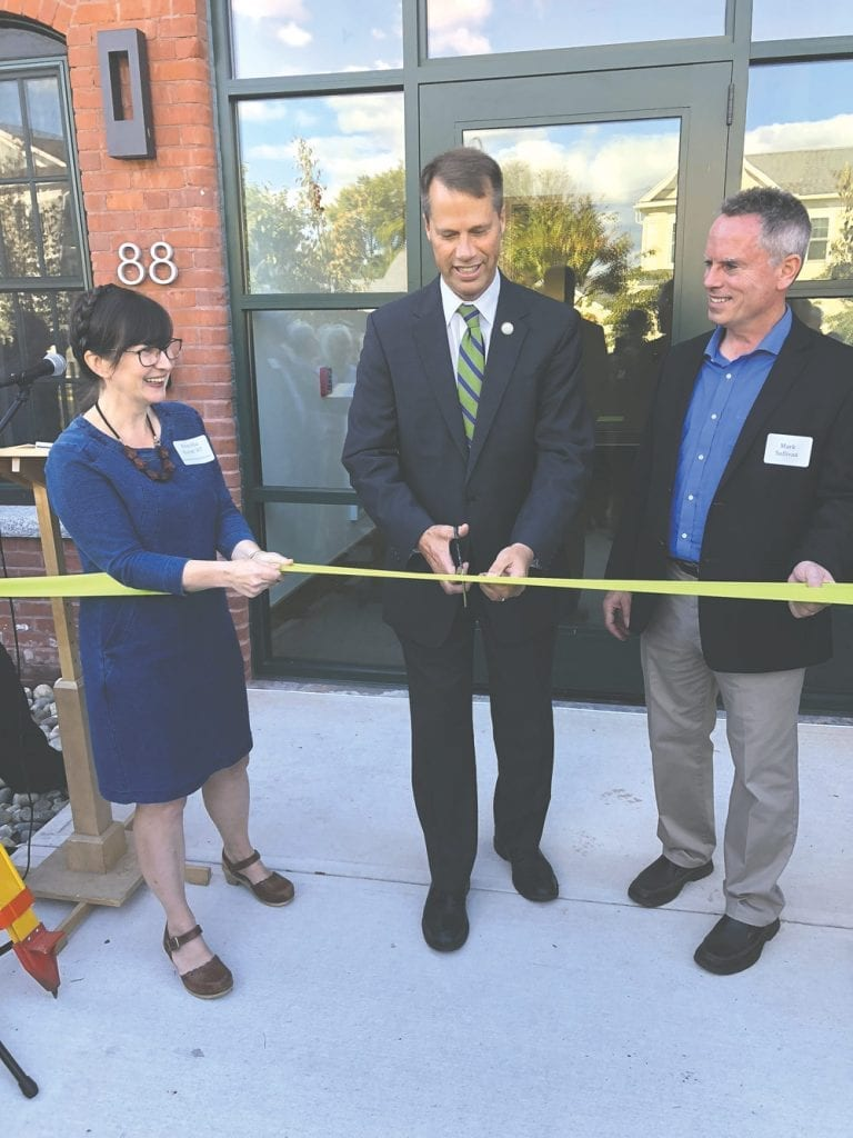 Mayor David Narkewicz cuts the ribbon