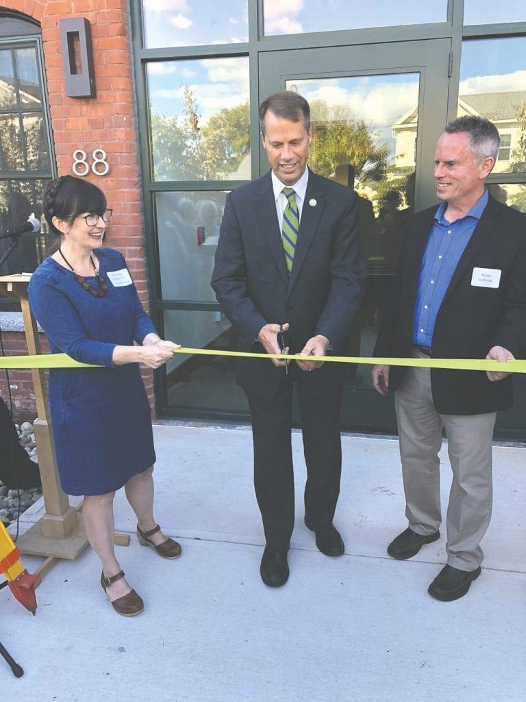 Mayor David Narkewicz cuts the ribbon