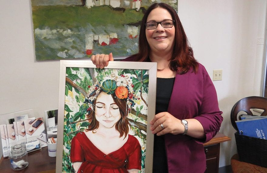 Jessica Roncariti-Howe, here displaying one of her own paintings